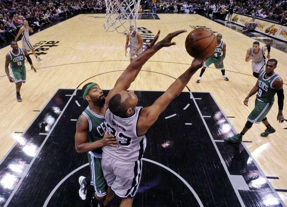 San Antonio Spurs' Boris Diaw shoots around Boston Celtics' Chris Wilcox during second half action Saturday Dec. 15, 2012 at the AT&T Center. The Spurs won 103-88. (Edward A. Ornelas / San Antonio Express-News)