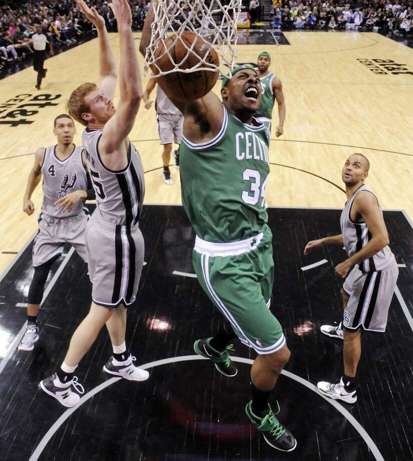 Boston Celtics' Paul Pierce reacts after a dunk against the San Antonio Spurs' Matt Bonner during first half action Saturday Dec. 15, 2012 at the AT&T Center. The Spurs won 103-88. (Edward A. Ornelas / San Antonio Express-News)