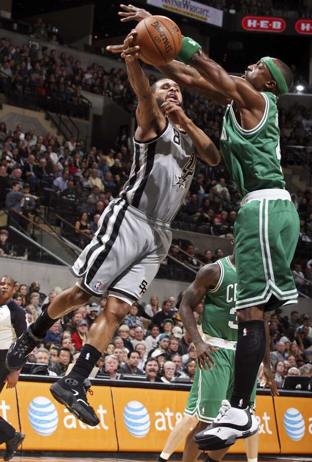 San Antonio Spurs' Patty Mills passes around Boston Celtics' Jason Terry during first half action Saturday Dec. 15, 2012 at the AT&T Center. (Edward A. Ornelas / San Antonio Express-News)
