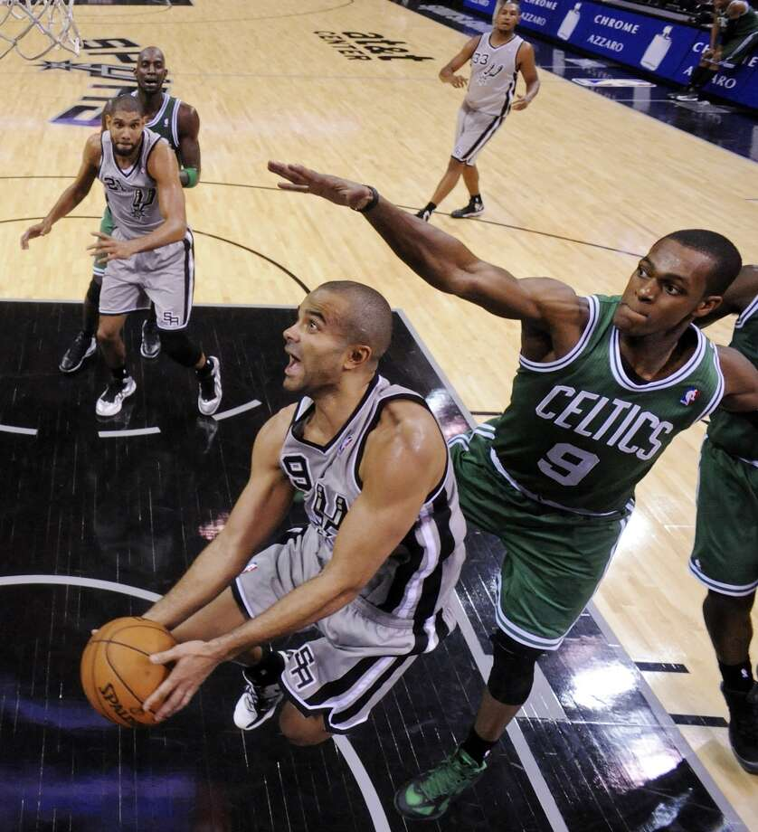 San Antonio Spurs' Tony Parker shoots around Boston Celtics' Rajon Rondo during second half action Saturday Dec. 15, 2012 at the AT&T Center. The Spurs won 103-88. (Edward A. Ornelas / San Antonio Express-News)