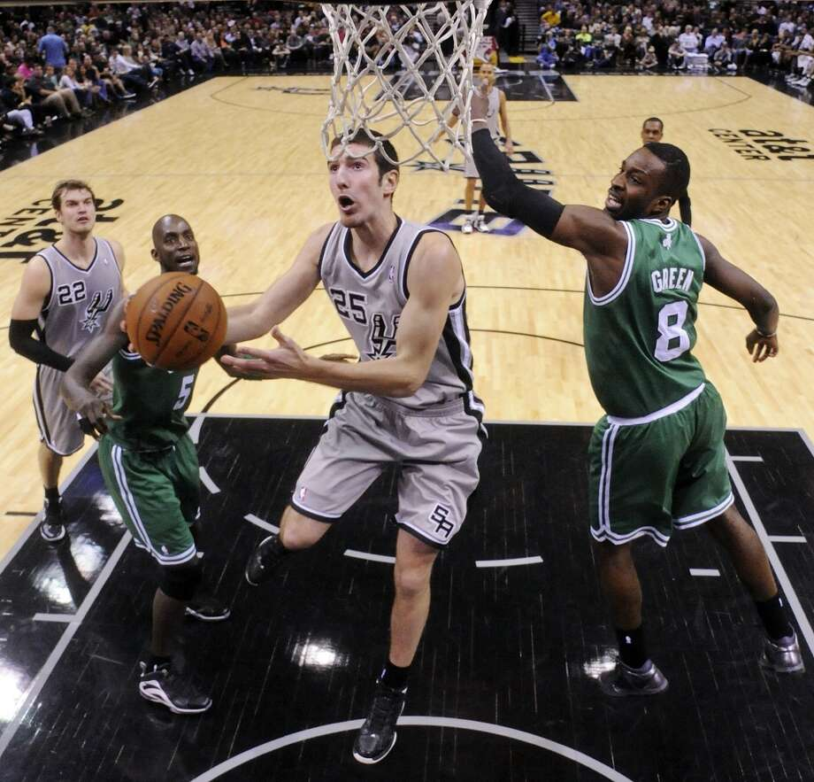 San Antonio Spurs' Nando De Colo shoots around Boston Celtics' Jeff Green during second half action Saturday Dec. 15, 2012 at the AT&T Center. The Spurs won 103-88. (Edward A. Ornelas / San Antonio Express-News)