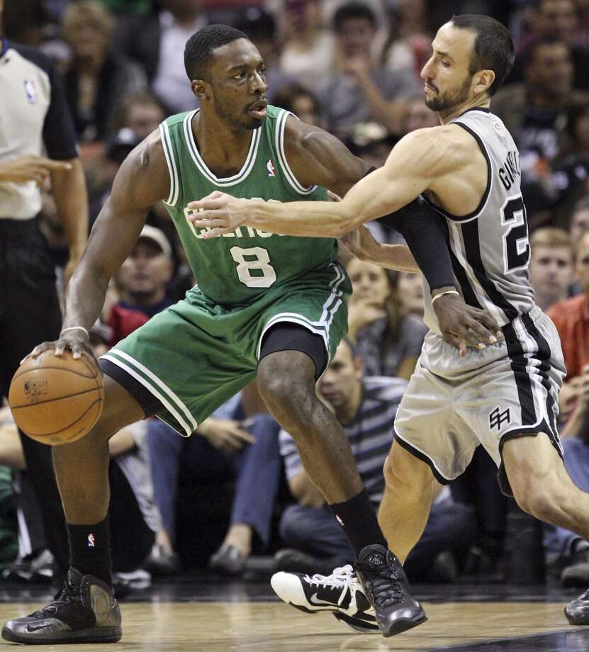 San Antonio Spurs' Manu Ginobili defends Boston Celtics' Jeff Green during first half action Saturday Dec. 15, 2012 at the AT&T Center. (Edward A. Ornelas / San Antonio Express-News)