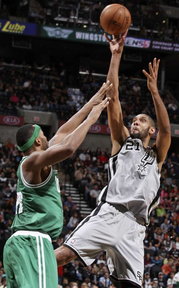 San Antonio Spurs' Tim Duncan shoots over Boston Celtics' Chris Wilcox during first half action Saturday Dec. 15, 2012 at the AT&T Center. (Edward A. Ornelas / San Antonio Express-News)