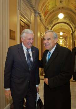 U.S. Rep. Charlie Gonzalez, who is leaving Congress after 14 years, greets his good friend Steny Hoyer (left), D-Md., in the halls of the Capitol as he spends one of his final days taking friends and staff on a tour Dec. 13, 2012. Photo: Dayna Smith,  For The Express-News / Dayna Smith