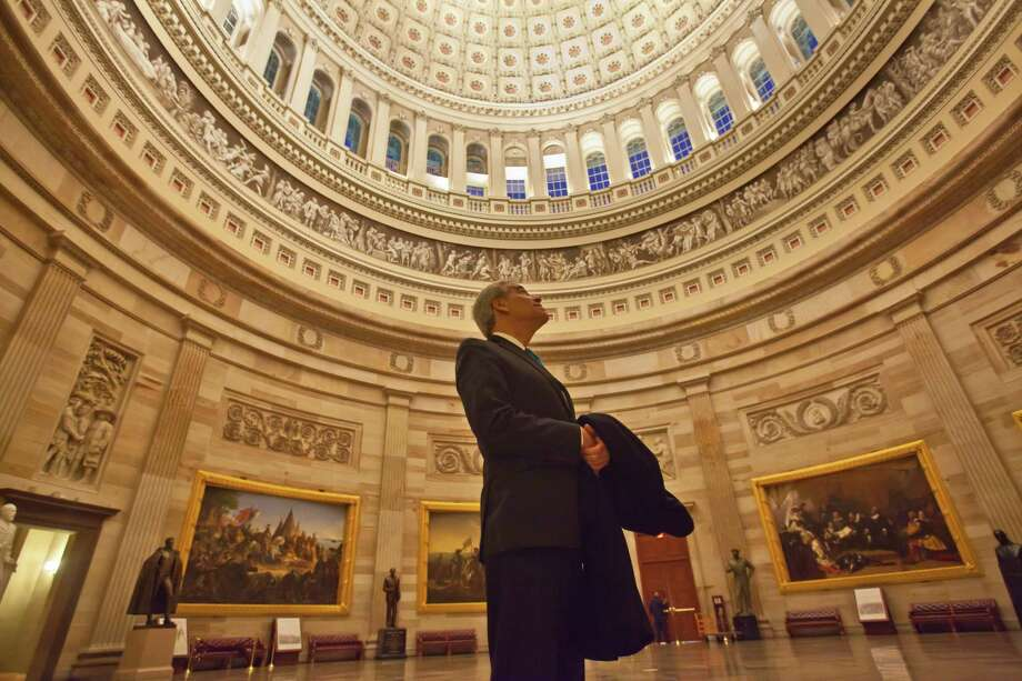 U.S. Rep. Charlie Gonzalez, D-San Antonio, pauses to gaze up at the Capitol Rotunda on one of his final days as a member of Congress. He was first elected to the House of Representatives in 1998. Photo: Dayna Smith,  For The Express-News / Dayna Smith