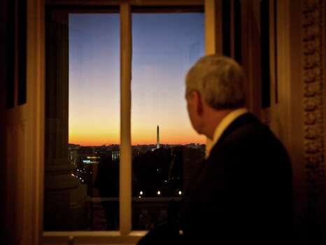 U.S. Rep. Charlie Gonzalez, D-San Antonio, pauses to take in a view of the Washington Monument from a window in the U.S. Capitol Building on Dec. 13, 2012. Photo: Dayna Smith,  For The Express-News / Dayna Smith