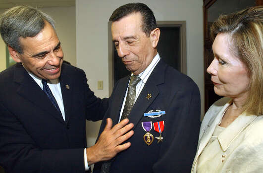 Richard Buitron receives the Combat Infantry Badge from U.S. Rep. Charlie Gonzalez, D-San Antonio, as Buitron's wife Leticia looks on May 29, 2003. Photo: Tom Reel, San Antonio Express-News / SAN ANTONIO EXPRESS-NEWS