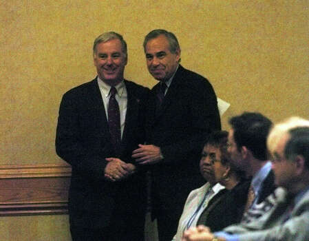 Democratic National Committee Chairman Howard Dean chats with U.S. Rep. Charlie Gonzalez, D-San Antonio, at the Hispanic Leadership Summit in San Antonio on Aug. 6, 2005. Photo: Billy Calzada, San Antonio Express-News / SAN ANTONIO EXPRESS-NEWS