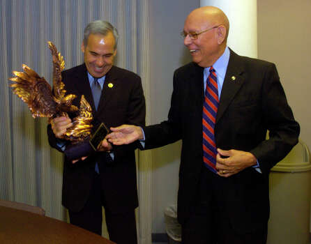 U.S. Rep. Charlie Gonzalez, D-San Antonio, holds the Henry B. Gonzalez Public Service and Integrity Award on Dec. 12, 2005, at San Antonio College. To his right is one of this year's recipients, Tino Duran, who heads the La Prensa Foundation with his wife, Amelia Duran, who was unable to attend the ceremony. Photo: John Davenport, San Antonio Express-News / SAN ANTONIO EXPRESS-NEWS