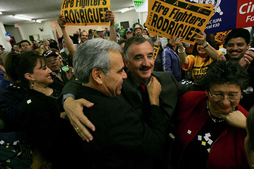 Ciro Rodriguez is congratulated by U.S. Rep. Charlie Gonzalez, D-San Antonio, at the Harlandale Civic Center on Dec. 12, 2006, after Rodriguez beat incumbent Republican Henry Bonilla in the District 23 runoff. Photo: Jerry Lara, San Antonio Express-News / SAN ANTONIO EXPRESS-NEWS