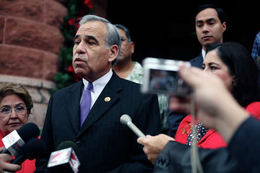 U.S. Rep. Charles Gonzalez, D-San Antonio, and many of Bexar County's major Democratic officeholders hold a press conference on Dec. 22, 2009, to discuss the state of the local Democratic Party and how it might emerge from financial ruin in time for the 2010 primaries. Photo: San Antonio Express-News File Photo / sdulai@express-news.net