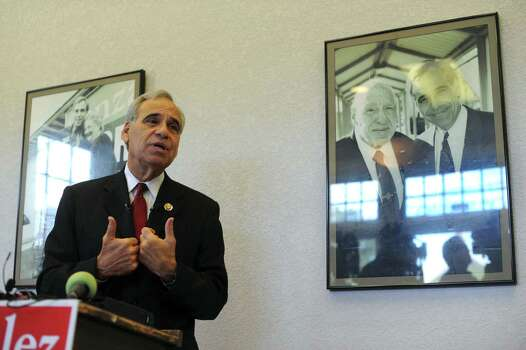 U.S. Rep. Charlie Gonzalez, D-San Antonio, announces that he will not seek reelection during a press conference on Nov. 26, 2011. Thirteen years ago, Gonzalez succeeded his father, Henry B. Gonzalez, who is shown in the picture at right. Photo: Billy Calzada, San Antonio Express-News / gcalzada@express-news.net