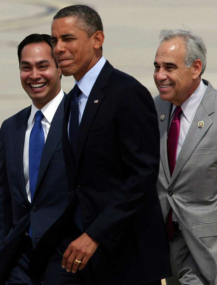 President Barack Obama walks with Mayor Julián Castro and U.S. Rep. Charlie Gonzalez, D-San Antonio, upon Obama's arrival at San Antonio International Airport on July 17, 2012. Obama is attending two fundraising events, one at the Convention Center and another one at a private residence in the Dominion. Photo: Jerry Lara, San Antonio Express-News / © 2012 San Antonio Express-News