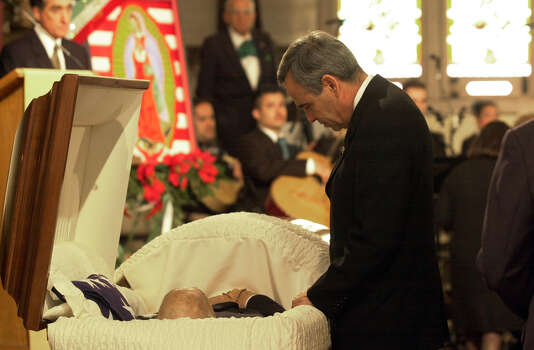U.S. Rep. Charlie Gonzalez, D-San Antonio, says goodbye to his father, former Congressman Henry B. Gonzalez, Dec. 2, 2000, at San Fernando Cathedral. Photo: San Antonio Express-News File Photo / EN