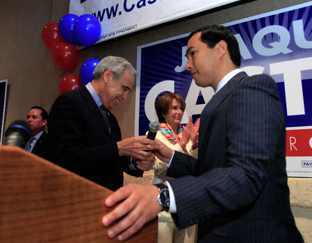 U.S. Rep. Charlie Gonzalez, D-San Antonio, passes the microphone to congressional candidate Joaquín Castro while House Minority Leader Nancy Pelosi applaudes at a breakfast rally for Castro, who is running for the seat Gonzalez is vacating, at Avenida Guadalupe's El Progreso Hall on Feb. 18, 2012. Photo: J. Michael Short, For The San Antonio Express-News / THE SAN ANTONIO EXPRESS-NEWS
