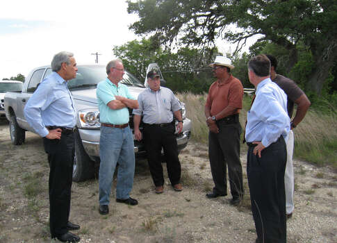 Congressman Charlie Gonzalez (left), Mayor Phil Hardberger and Congressman Ciro Rodriguez (far right) listen to Camp Bullis staff members Michael Ball, (center), Gilbert Trinidad and Vincent Yullie talk about the $4.2 million dollar urban training facility and review theater on Camp Bullis on July 21, 2008. Photo: Tomas Larralde, Courtesy Photo