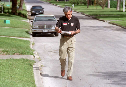 Congressional hopeful Charlie Gonzalez checks his clipboard for the next house on his route as he block-walks in a neighborhood of W. Woodlawn Avenue on March 26, 1998. Photo: San Antonio Express-News File Photo / SAN ANTONIO EXPRESS-NEWS