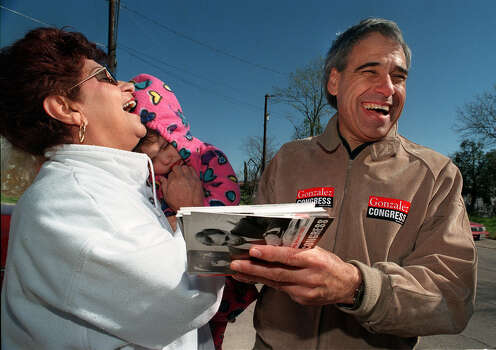 Congressional hopeful Charlie Gonzalez shares a laugh with Rosie Moran and her granddaughter, Lindsey Dubbles, 2, on March 3, 1998. Photo: San Antonio Express-News File Photo / SAN ANTONIO EXPRESS-NEWS