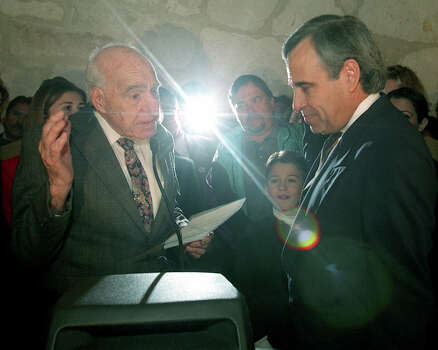 Former US. Rep Henry B. Gonzalez swears in his son, Charlie Gonzalez, in as a U.S. House member at the Southwest Craftcenter on Jan. 23, 1999. Photo: San Antonio Express-News File Photo / SAN ANTONIO EXPRESS-NEWS