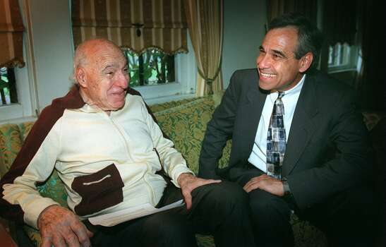 Henry B. Gonzalez (left) chats with his son, Charlie Gonzalez, in Henry's house on March 5, 1998. Photo: San Antonio Express-News File Photo / SAN ANTONIO EXPRESS-NEWS