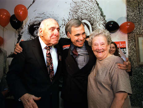 Henry B. (left) and Bertha Gonzalez are hugged by their son Charlie at a victory party at Estela's Restaurant after Charlie won Henry's 20th Congressional District seat on Nov. 3, 1998. Photo: San Antonio Express-News / SAN ANTONIO EXPRESS-NEWS