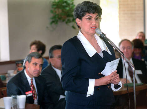 Maria Berriozabal answers a question as Charlie Gonzalez contemplates his response to the same topic during a debate for candidated for Texas's 20th congressional district seat on March 21, 1998. Photo: Tom Reel, San Antonio Express-News / SAN ANTONIO EXPRESS-NEWS