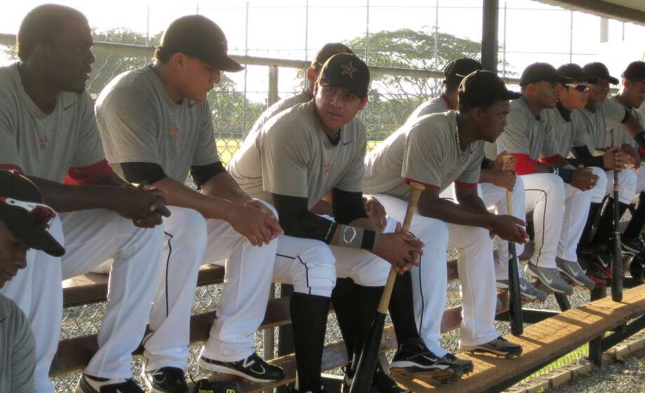 Players on the Astros' Dominican Republic instructional team prepare to play a game Monday at Houston's training academy in Guerra, Santo Domingo. (Brian T. Smith/Houston Chronicle)
