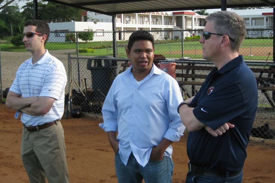 Astros assistant general manager David Stearns, GM Jeff Luhnow and international director Oz Ocampo wait Monday for practice to start at Houston's Dominican Republic instructional academy in Guerra, Santo Domingo.  (Brian T. Smith/Houston Chronicle)