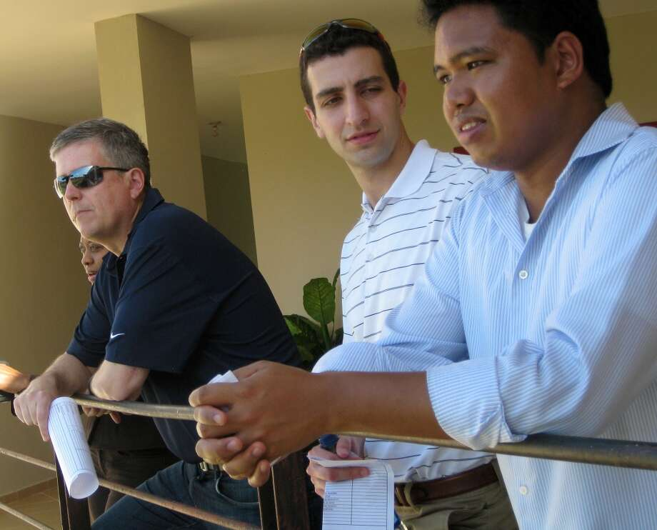 Astros general manager Jeff Luhnow, assistant GM David Stearns and international director Oz Ocampo look out Monday at Houston's Dominican Republic instructional academy in Guerra, Santo Domingo.  (Brian T. Smith/Houston Chronicle)