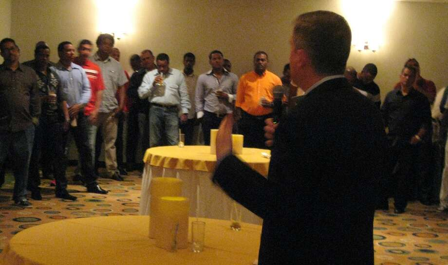 Astros general manager Jeff Luhnow addresses Monday a group of Dominican Republic-based agents and trainers at a hotel in Santo Domingo.  (Brian T. Smith/Houston Chronicle)
