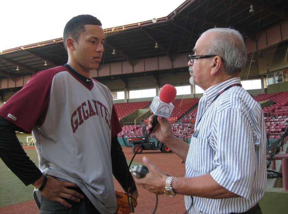 Astros shortstop Carlos Correa is interviewed by Caribbean Sports News director Roy Cosme on Tuesday prior to Gigantes de Carolina's 3-1 victory against Leones de Ponce at Estadio Francisco Montaner in Ponce, Puerto Rico.  (Brian T. Smith/Houston Chronicle)