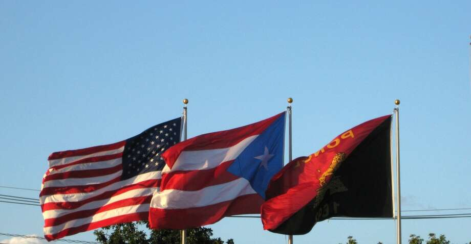Flags outside the centerfield wall at Estadio Francisco Montaner in Ponce, Puerto Rico.  (Brian T. Smith/Houston Chronicle)