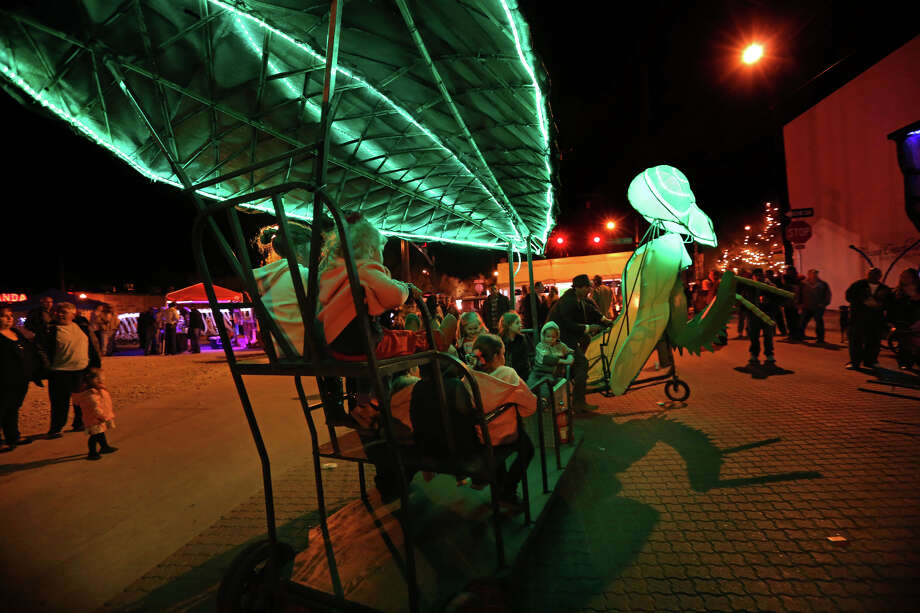 """""""A street party and art showing rolled into one, Artwalk draws thousands of visitors each November to Alpine to listen to live music, enjoy a main street parade and peruse the offerings of some two dozen artists and craftsmen."""""""