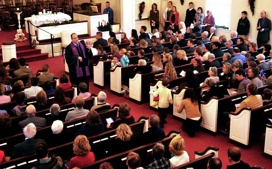 The Rev. Matthew Crebbin, senior pastor of Newtown Congregational Church, speaks about the recent tragedy during Sunday mass, Dec. 16, 2012. Photo: Michael Duffy