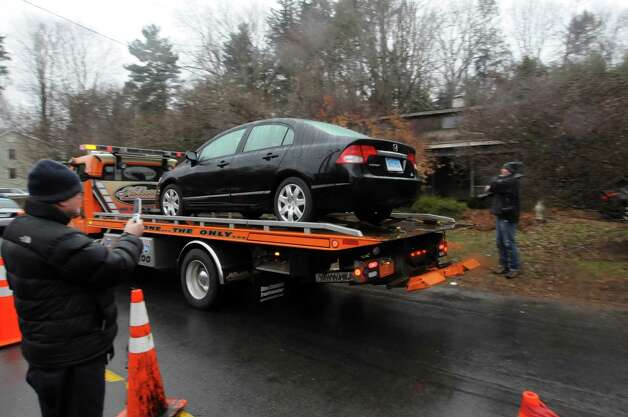 A black Honda Civic is transported from the Sandy Hook Elementary School crime scene, Sunday Dec. 16, 2012, in Newtown Conn. The car appears to match a description of the vehicle Adam Lanza drove to the school on the day of the tragic shooting on Dec. 14, 2012. Photo: Will Waldron, Hearst Newspapers/Will Waldron / The News-Times