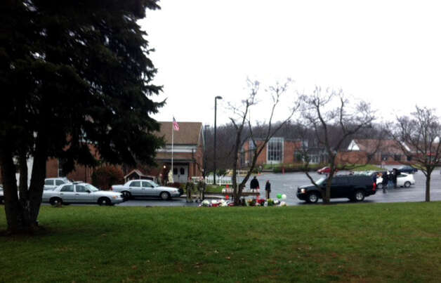 Parishioners at St. Rose of Lima Church in the Sandy Hook section of Newtown, Conn. was evacuated during mass because of an unspecified threat on Sunday, Dec. 16, 2012. Local and state police, including heavily armed officers were at the scene. Photo: B.K. Angeletti / Connecticut Post Freelance