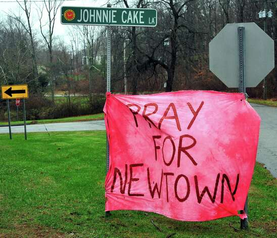 There are homemade signs around Newtown Sunday, Dec. 16, 2012. Photo: Michael Duffy