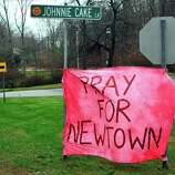 There are homemade signs around Newtown Sunday, Dec. 16, 2012.