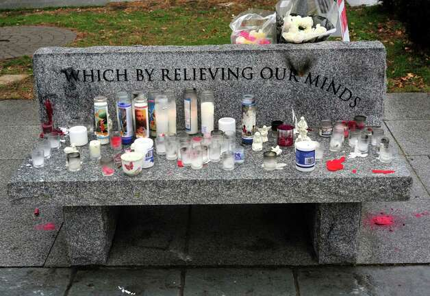 There are memorials outside Edmond Town Hall in Newtown Sunday, Dec. 16, 2012. Photo: Michael Duffy