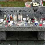 There are memorials outside Edmond Town Hall in Newtown Sunday, Dec. 16, 2012.