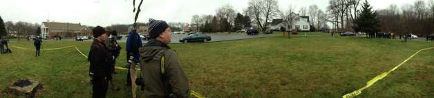 Parishioners at St. Rose of Lima Church in the Sandy Hook section of Newtown, Conn. was evacuated during mass because of an unspecified threat on Sunday, Dec. 16, 2012. Local and state police, including heavily armed officers were at the scene. Photo: Will Waldron, Hearst Newspapers/Will Waldron / The News-Times