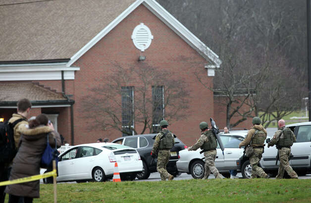 State police check buildings on the St. Rose of Lima Church campus in the Sandy Hook section of Newtown, Conn. after an unspecified threat on Sunday, Dec. 16, 2012. Parishioners were evacuated during noon mass. Photo: BK Angeletti, B.K. Angeletti / Connecticut Post freelance B.K. Angeletti