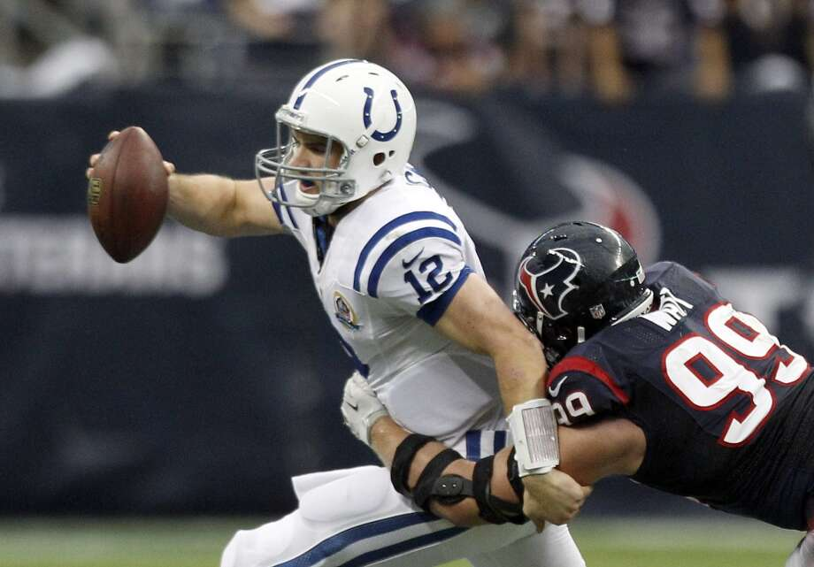 Colts quarterback Andrew Luck gets pressured by Texans defensive end J.J. Watt. (Brett Coomer / Houston Chronicle)