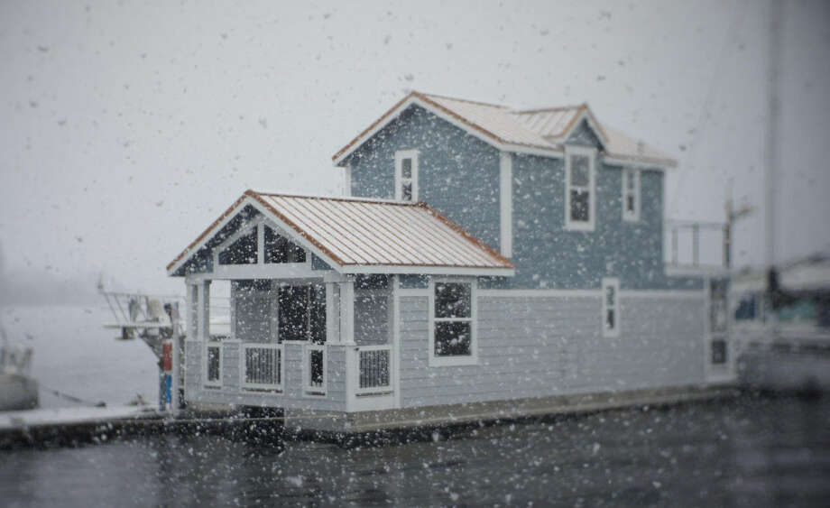 Steve Bimson says his two-story, 850-square-foot houseboat at Boat World Marina near Gas Works Park would not qualify for an amnesty proposed by some City Council members. That's because Bimson's house is too tall to meet the amnesty's height limit. Photo: Steve Bimson.