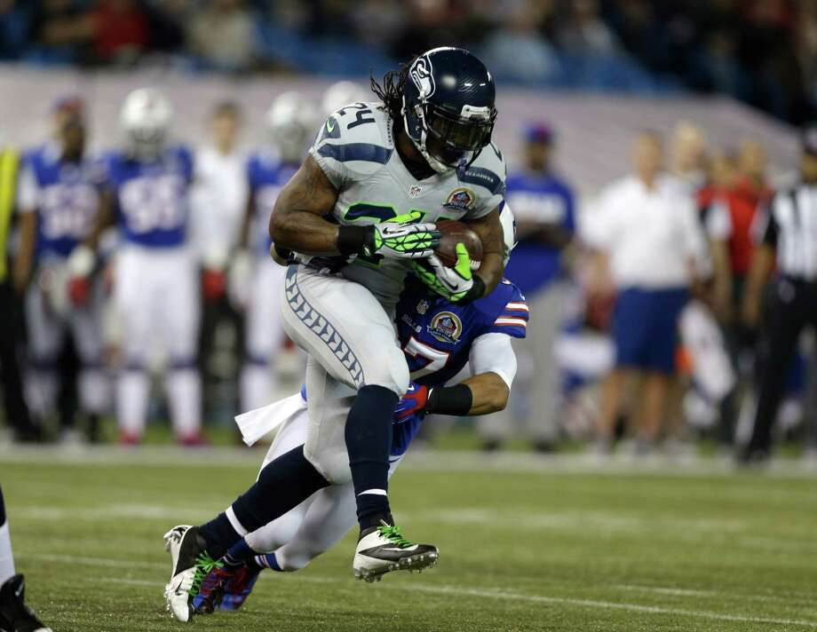 Seattle Seahawks running back Marshawn Lynch (24) runs against the Buffalo Bills during the first half of an NFL football game on Sunday, Dec. 16, 2012, in Toronto. Photo: AP