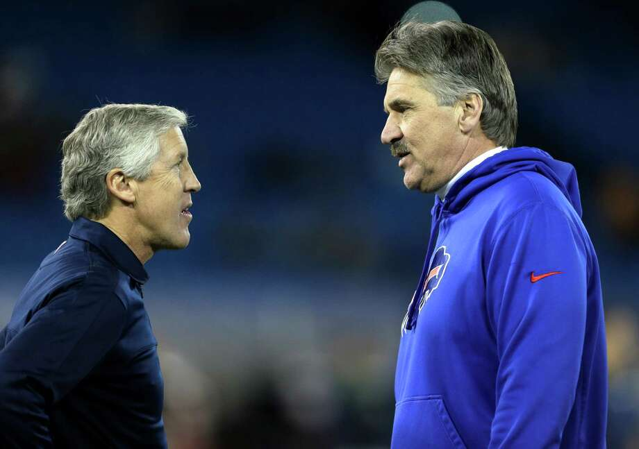 Seattle Seahawks head coach Pete Carroll, left, talks with Buffalo Bills defensive coordinator Dave Wannstedt before an NFL football game on Sunday, Dec. 16, 2012, in Toronto. Photo: AP