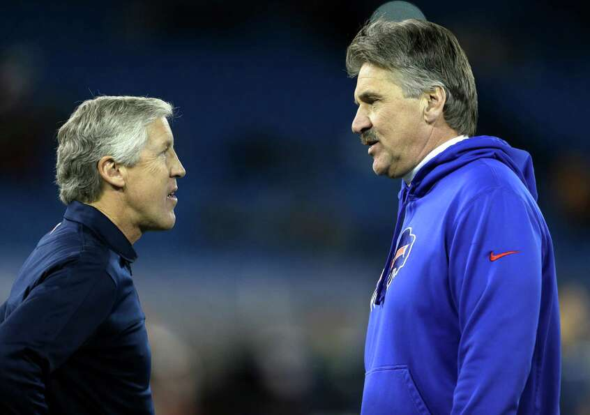 Seattle Seahawks head coach Pete Carroll, left, talks with Buffalo Bills defensive coordinator Dave