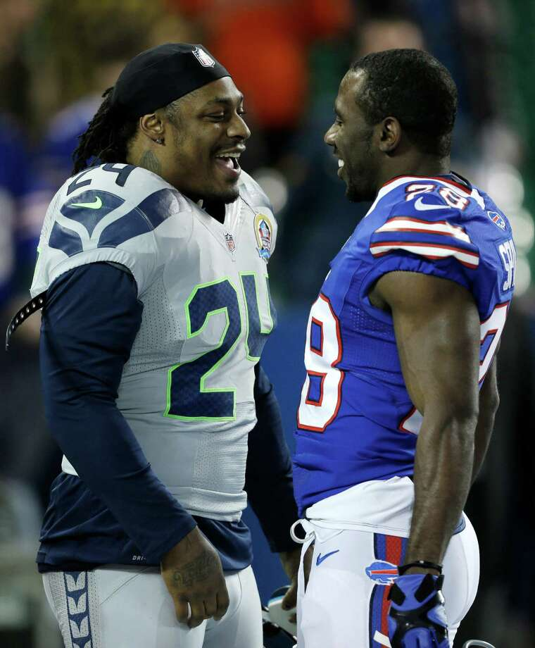 Seattle Seahawks running back Marshawn Lynch (24) and Buffalo Bills running back C.J. Spiller (28) talk before an NFL football game on Sunday, Dec. 16, 2012, in Toronto. Photo: AP