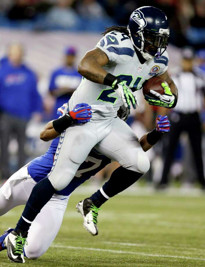 Seattle Seahawks running back Marshawn Lynch (24) is tackled by Buffalo Bills strong safety George Wilson (37) during the first half of an NFL football game, Sunday, Dec. 16, 2012, in Toronto. Photo: AP