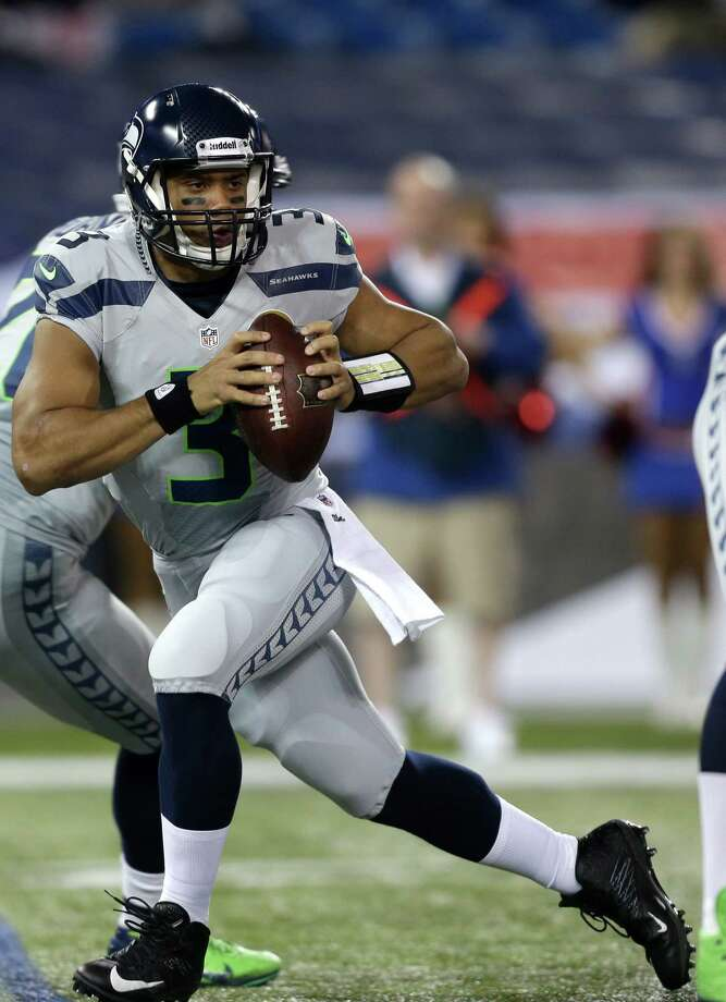 Seattle Seahawks quarterback Russell Wilson (3) looks to pass against the Buffalo Bills during the first half of an NFL football game on Sunday, Dec. 16, 2012, in Toronto. Photo: AP